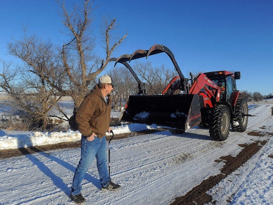 Craig Jaton returns to the site on Jan. 14, 2016 where he was pinned by a tractor while cutting trees in rural Irene in May of 2014. The tractor at right was the same tractor that was in the accident.