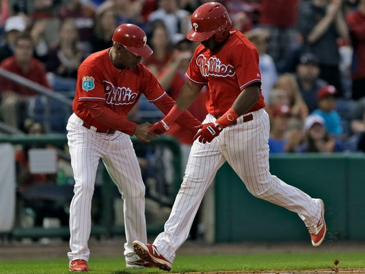 Philadelphia Phillies' Maikel Franco, right, shakes hands with third base coach Juan Samuel after hitting a home run off Toronto Blue Jays starting pitcher Marco Estrada during the third inning of a spring training baseball game Friday, March 25, 2016, in Clearwater, Fla. (AP Photo/Chris O'Meara)