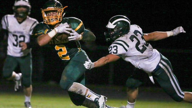 St. Mark's wide receiver Austin Colmery , seen here against Archmere, had a rushing touchdown in the Spartans' 35-20 win over St. Elizabeth's on Friday.