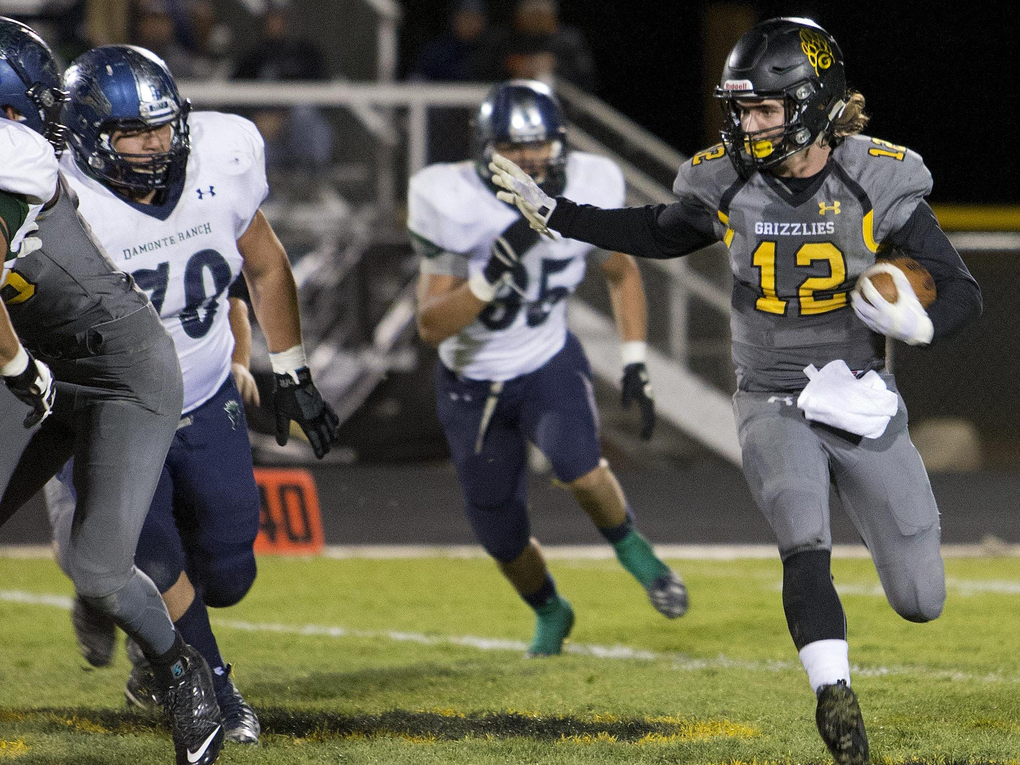 Galena's Quintin Mills runs around the outside of the Damonte Ranch defense during Thursday's game.
