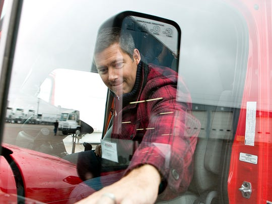 Rep. Sean Duffy closes the door on a Roehl semi-trailer before taking it for a ride in the practice yard Monday during the congressman's tour of Roehl Transport in Marshfield.