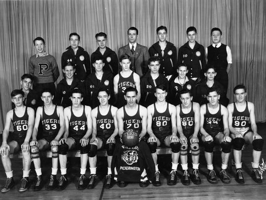 The 1938-39 basketball team of Violet Township in Pickerington is pictured. In the front row, from left, are Junior Weaver, Irvine Wetherell, Howard Cathers, James Kraner, Lloyd Williamson, Stanley Badger, Dale Huntwork, Lester Williamson and Louis Boyer; second row, Harry Smith, Carl Walton, Talmadge Johnson, Robert Beery, James Fenstermaker, Lawrence Doty, John Reese; back row, Norman Fenstermaker, manager Jack Drugan, Kenneth Patrick, coach L.C. Morris, Norman Brobst, Wendell Manson and assistant manager Caryl Reaver.