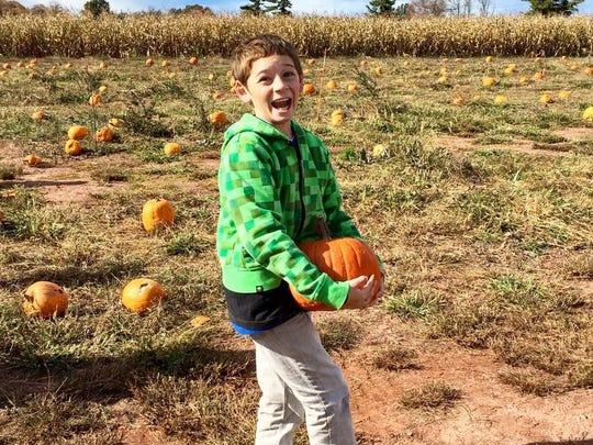 Gabe Forbes in a pumpkin patch.