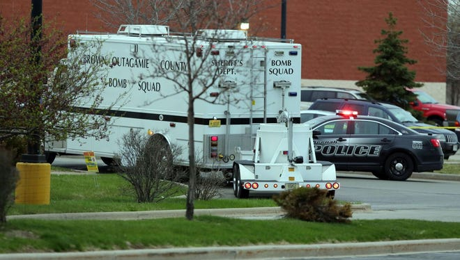 The Brown-Outagamie Bomb Squad arrives to investigate suspicious packages in the parking lot between Kohl's and Wal-Mart on Sunday in Neenah.