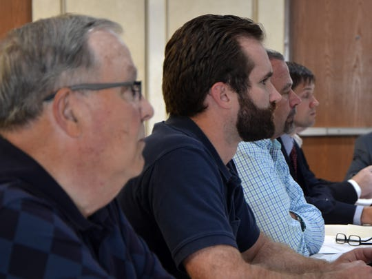 Springfield City Manager Nathan Henne, center, and