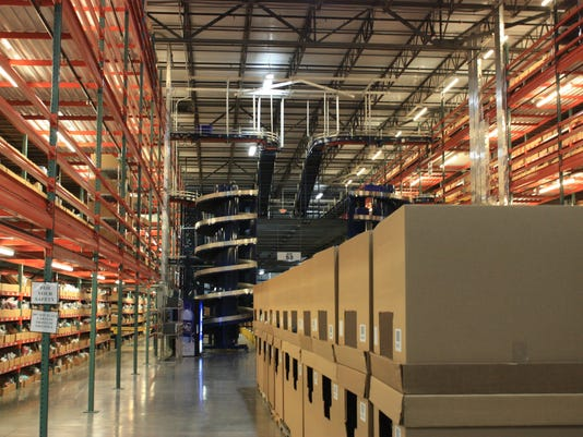 Items are stacked at one of omnichannel commerce technology company Radial's fulfillment centers.
