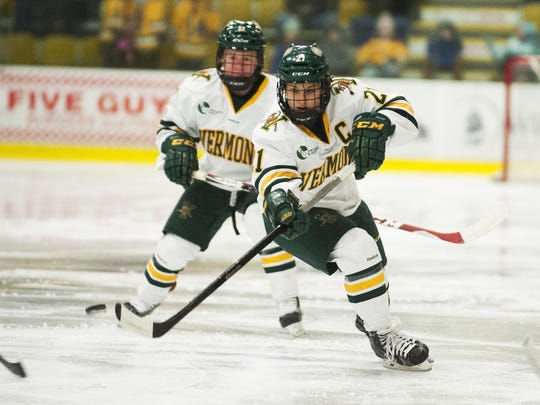 Former UVM forward Amanda Pelkey (21) skates down the ice with the puck during the women's hockey game at Gutterson Fieldhouse in 2015.