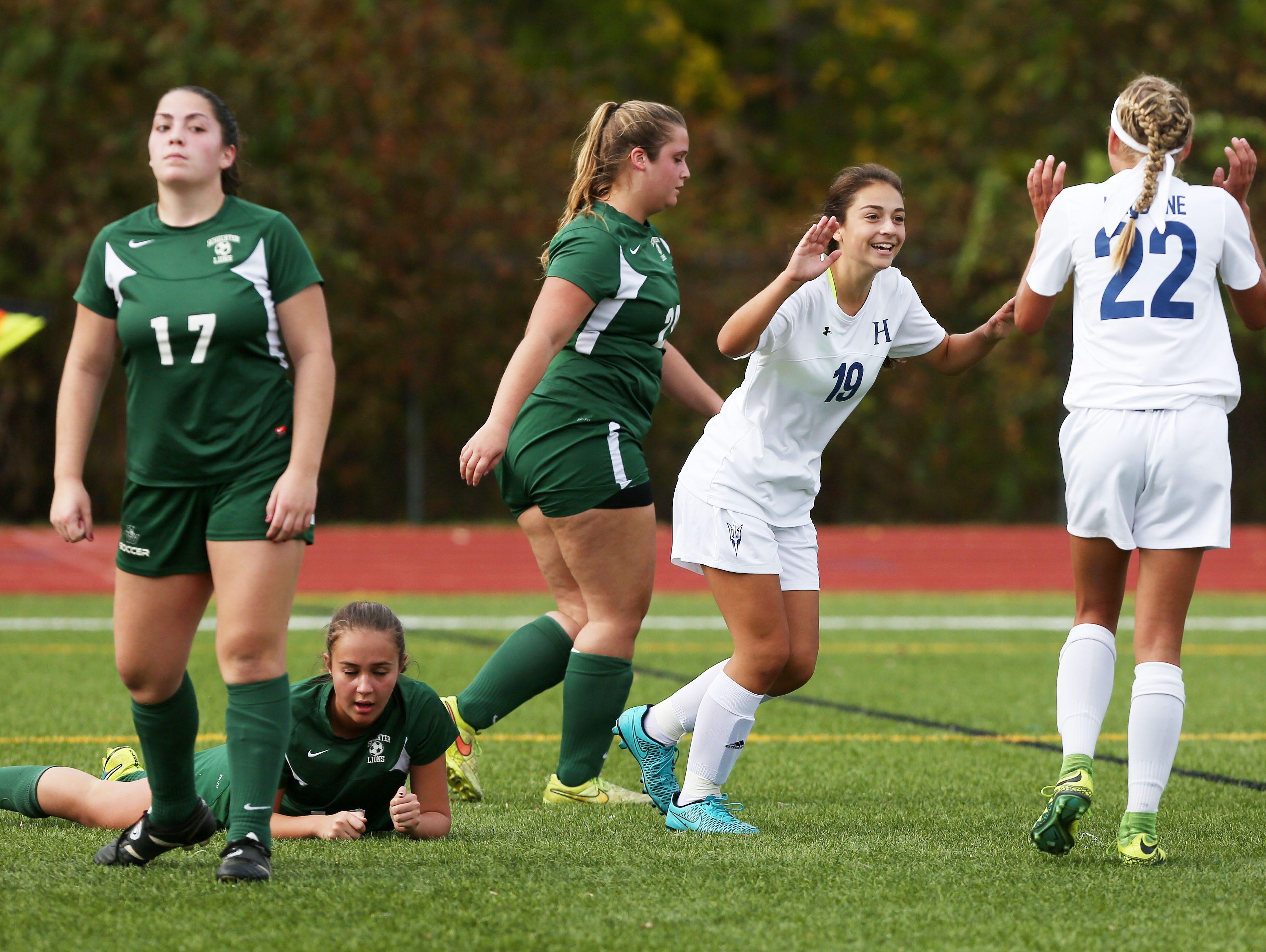 Haldane's Robin Ben-Adi (19) celebrates her second half goal with teammates against Schechter in the girls soccer Section 1 Class C championship game at Yorktown High School Oct. 30, 2016. Haldane won the game 3-0.