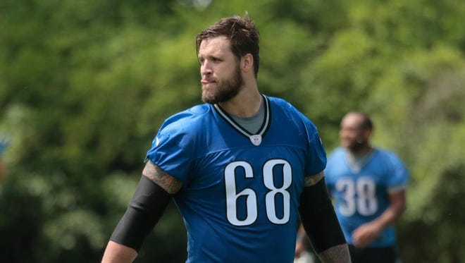 Lions offensive tackle Taylor Decker walks off the field after practice earlier this summer. Decker, a rookie out of Ohio State, is expected to be a starter this fall.