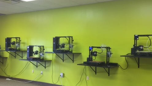 A wall of 3D printers at Futurescape 3D, which opens Oct. 1.
