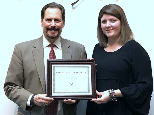 Pathways President and CEO Edward J. Lukomski presents Savannah Monroe with the Employee of the Quarter award.