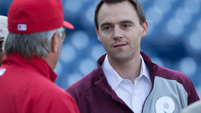 Philadelphia Phillies general manager Matt Klentak (R) talks with manager Pete Mackanin (L) before an April game against the Washington Nationals at Citizens Bank Park.