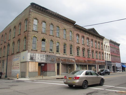 Chemung County has seized a handful of empty buildings on Lake Street in Elmira for back taxes and will seek to redevelop the site.