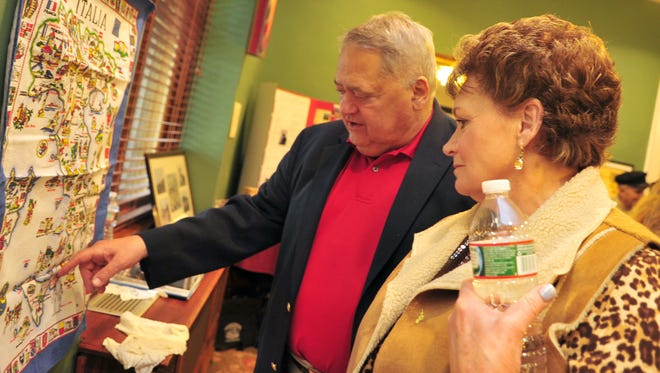 """Mike and Pat Guarino of Denville talk about travel to Italy. The Denville Chapter of UNICO National hosts """"Re-Discover Your Italian Heritage"""" to celebrate the culture, traditions and history of Italian Americans. More than 125 people attended the event held at St. Francis Center, Denville, NJ. Sunday, April 26, 2015."""