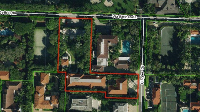 An arial photo from the Palm Beach County Property Appraiser's website shows the L-shaped estate at 102 Flager Drive in Palm Beach outlined in red. The estate was home to Kenneth and Janet Himmel and just sold for a recorded $18.348 million.