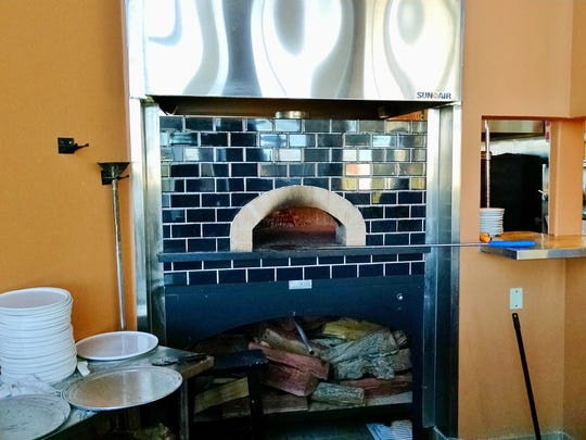 The wood-fired oven is made of Marra Forni brick and is from Napoli.