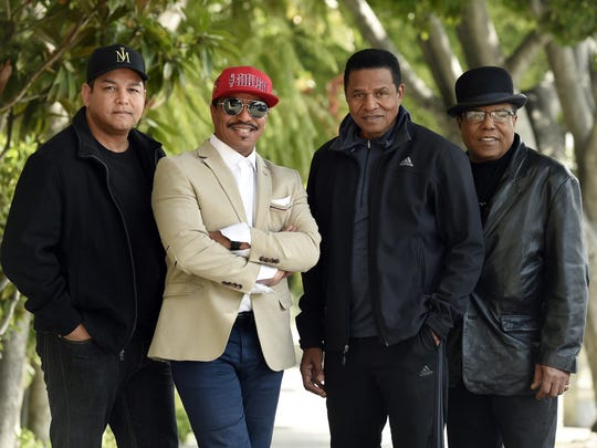 Marlon Jackson, second from left, Jackie Jackson, second from right, and Tito Jackson, far right, brothers of the late singer Michael Jackson, and Tito's son Taj, far left, pose together for a portrait Feb. 26, 2019, outside the Four Seasons Hotel, in Los Angeles.
