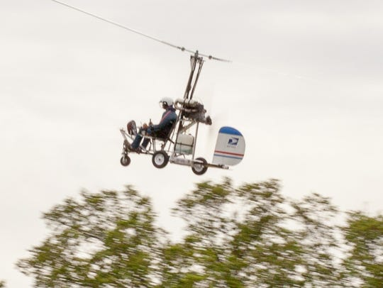A small helicopter lands on the West Lawn of the Capitol