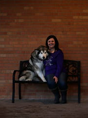Sabrina Czarapata, from Pulaski, and Casio, her 3-year-old Alaskan malamute, sit outside Parkside Animal Care Center in Green Bay. Czarapata showed Casio at the prestigious Westminster Kennel Club Dog Show in New York last week.