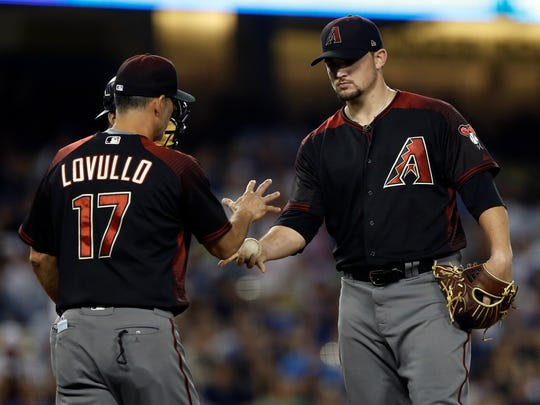 Arizona Diamondbacks manager Torey Lovullo (17) pulls