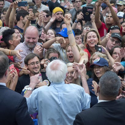 People try to shake hands with Democratic presidential candidate, Sen. Bernie Sanders, I-Vt, during a rally Friday at the Santa Fe Community College in Santa Fe, N.M.