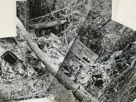 A 31-page casualty report from the military includes these photos of the crash site where Army Warrant Officer Gerald E. Woods' helicopter was shot down on Feb. 18, 1971, near the South Vietnam and Laos border. Woods was the pilot. No one survived.