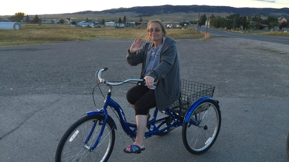 To stay fit, Judy Kenmir rides a three-wheel bike,