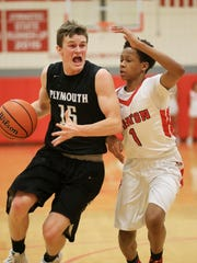 Plymouth's Pete Carravallah (left) tries to elude the