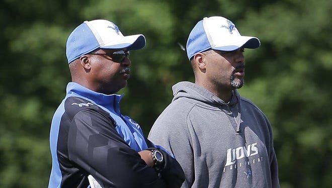 Detroit Lions coach Jim Caldwell, left, talks with defensive coordinator Teryl Austin during practice in Allen Park on June 3, 2014.