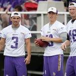 Minnesota Vikings kicker Blair Walsh (3) passes the ball to punter Jeff Locke during NFL football training camp