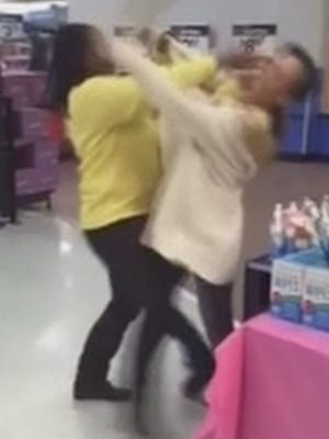 Police in Deer Park, Texas, have filed assault charges against Jessica Albitz, right, who headbutted another woman at a local Walmart on Feb. 7, 2015.