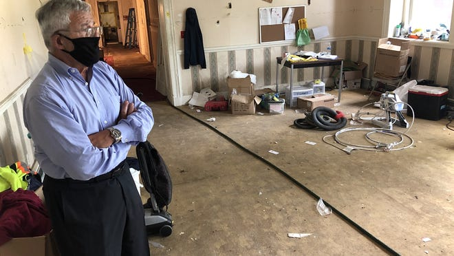 Fall River developer Robert Karam stands in what used to be a dining room inside the former Adams House nursing home on Highland Avenue.  Herald News photo by Charles Winokoor