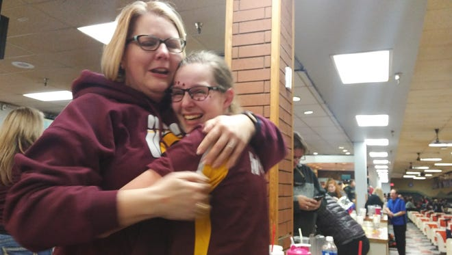 South Kitsap bowler Sarah Stolle (right) gets a hug from her mother, Robin, after winning the Class 4A state individual championship Friday at Narrows Plaza in University Place.