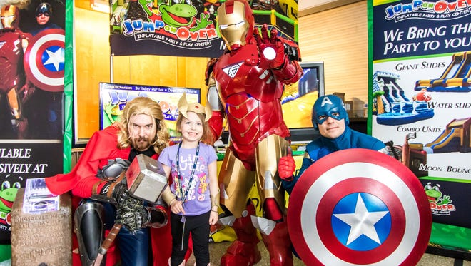 A pint-sized comic book fan poses with Thor, Iron Man and Captain America at last year's Galactic Con in Middletown.