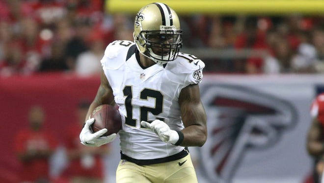 New Orleans Saints wide receiver Marques Colston (12) runs after a catch during their game against the Atlanta Falcons at the Georgia Dome. The Falcons won 37-34 in overtime.