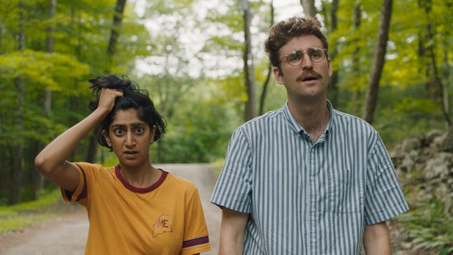 """Sunita Mani, left, stars as Su and John Reynolds, right, stars as Jack in writer-directors Alex Huston Fischer and Eleanor Wilson's """"Save Yourselves!"""" film."""