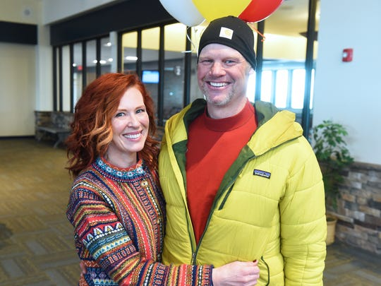 Suzette Bruggeman greets her husband Brett at the Great Falls International Airport, Monday.  Brett Bruggeman returned from Alaska where he competed in the Iditarod sled dog race, which he finished in 39th place as a first time competitor in the iconic race.
