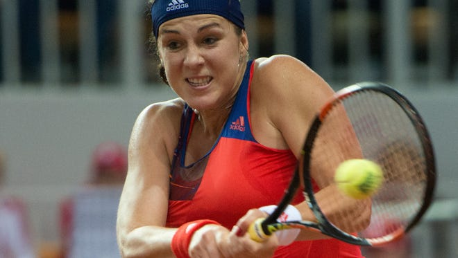 Anastasia Pavlyuchenkova of Russia returns a shot to Sabine Lisicki of Germany during their Fed Cup semifinal tennis match in Sochi, Russia.