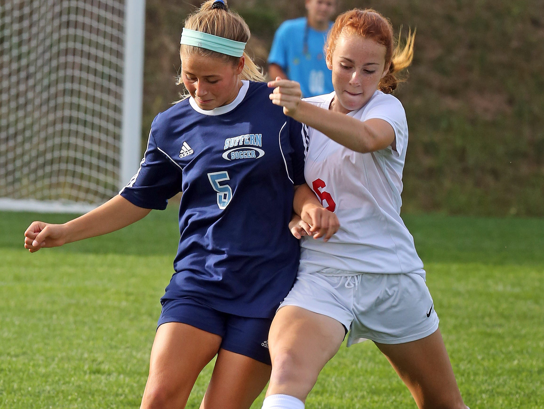 Suffern's Abby Bosco (5) and North Rockland's Phoebe Mullarky (26) battle for control of the ball during girls soccer game at North Rockland High School in Theills on Sept. 21, 2016.