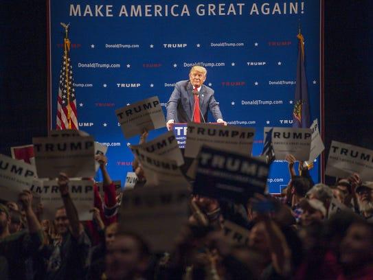 Republican presidential candidate Donald Trump looks