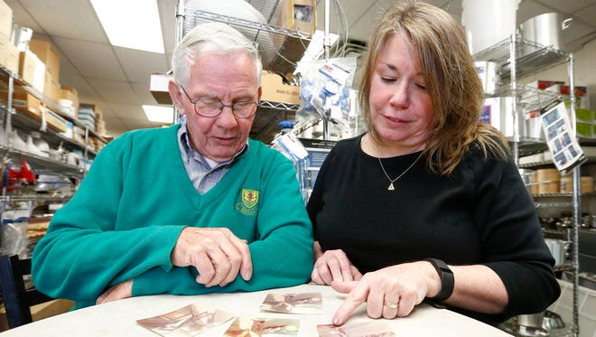 Carmel Reilly, right, and father Matt Reilly, look at old photographs at Bergen Restaurant Supply in Montvale, N. J. on Tuesday, February 28, 2017. Carmel Reilly will be the youngest female to be grand marshal at this years 55th Rockland County St. Patrick's Day Parade, 43 years after her father served as the grand marshal.