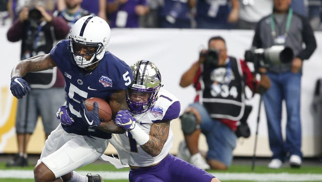 Penn State Nittany Lions wide receiver DaeSean Hamilton (5) runs in for the touchdown while being defended by Washington Huskies defensive back Byron Murphy (1) during the 47th PlayStation Fiesta Bowl at University of Phoenix Stadium in Glendale on December 30, 2017.