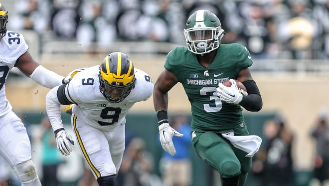 Michigan State Spartans running back LJ Scott (3) runs the ball against the Michigan Wolverines in the 2016 game.