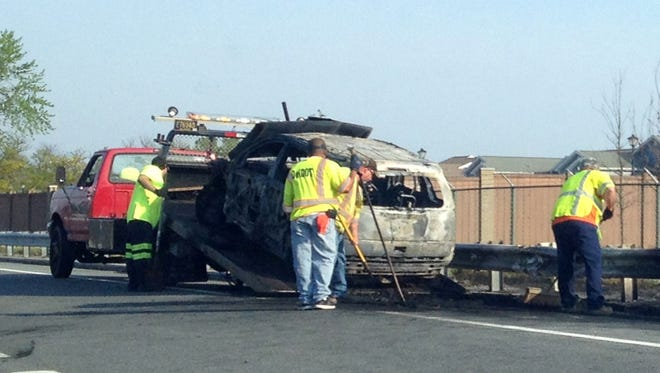 An SUV burned Thursday afternoon during a crash on Del. 1.