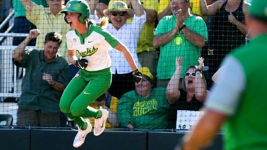 Oregon's Alexis Mack celebrates a late rally to defeat