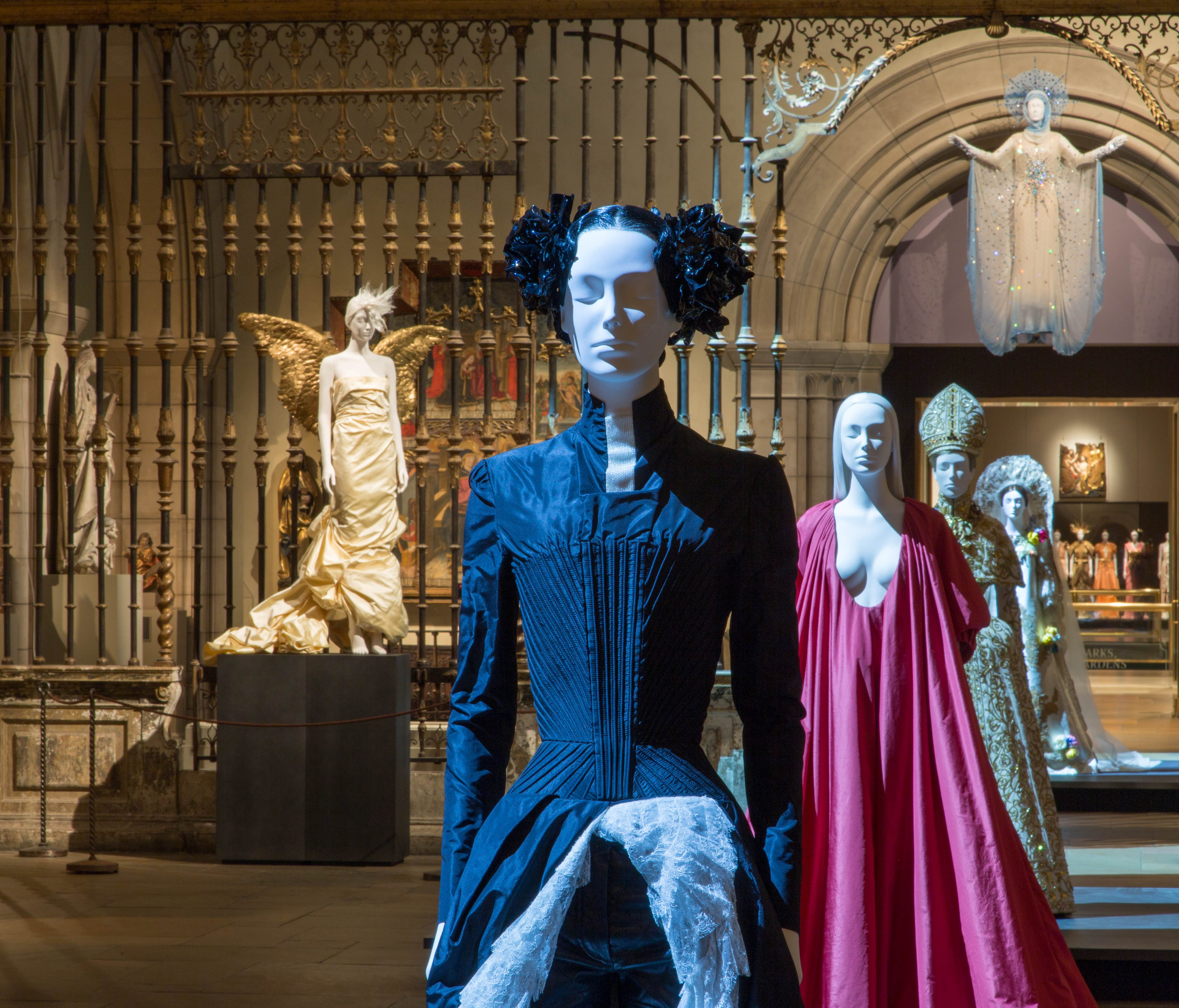 A view of the Medieval Sculpture Hall, including looks by Alexander McQueen, Valentino and Dior.