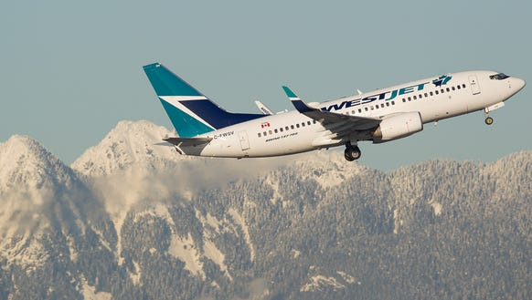 A WestJet Boeing 737-700 takes off from Vancouver International