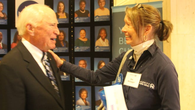 Joy Belanger shares a laugh with Lee Moffitt. Belanger was one of more than 80 volunteers present for the announcement of the Lee Moffitt Cancer Center's partnership with the Florida Department of Agriculture and Consumer Services.