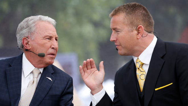 "ESPN ""College GameDay"" analysts Lee Corso and Kirk Herbstreit, right, work Oct 11, 2014."