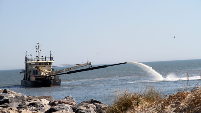 The dredge Currituck is seen dredging Rudee Inlet in this November 2012 handout image..
